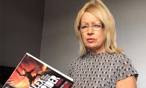 Fiona reading Alex Rider Scorpia